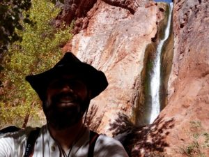 A shaded selfie of Upper Ribbon Falls